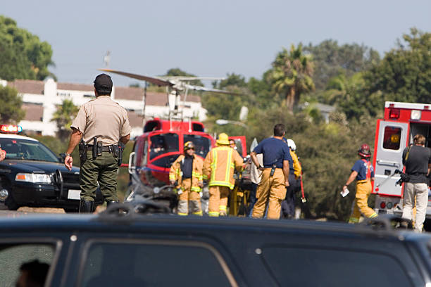 A helicopter stands ready to medi-vac an injured person to the hospital.